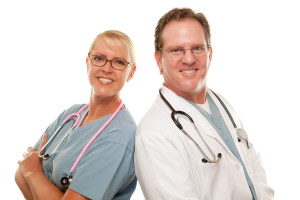 Friendly Male and Female Doctors Isolated on a White Background.